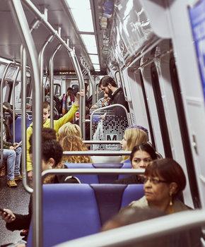 People sitting inside the DC metro