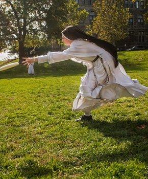 Nun playing frisbee at Catholic University - Washington, DC