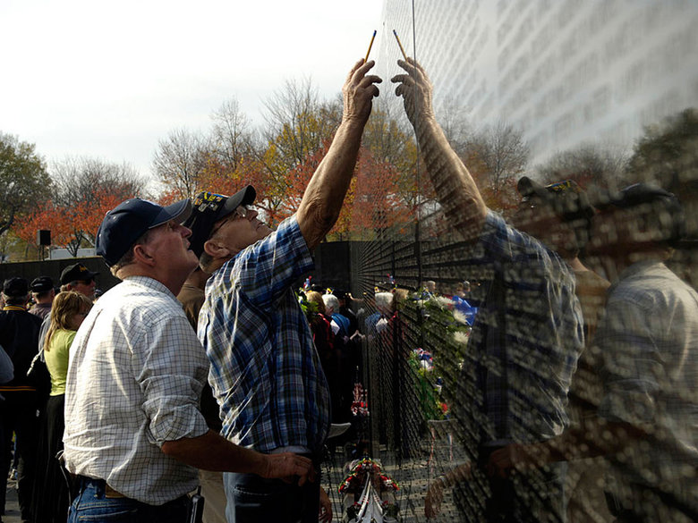 Vietnam Veterans at the Vietnam Veterans Memorial - Washington, DC