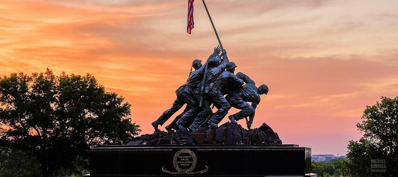 Visit the U.S. Marine Corps War Memorial (also known as the Iwo Jima Memorial)