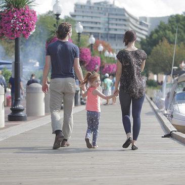 Family walking along Potomac River at the Georgetown Waterfront - Washington, DC